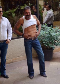 Sanjay Dutt walks out of jail in tatoo pony tail style